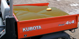 Kubota, a utility vehicle can carry liquids more efficiently with a Tuff Tech bag.  Photo by TUFF TECH